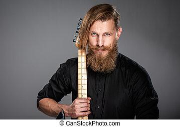 Closeup portrait of hipster man with guitar - Closeup...