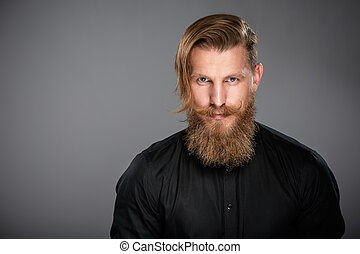 Closeup portrait of hipster man with beard and mustashes...