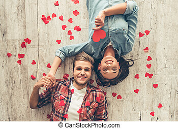 Happy young couple - Top view of happy young couple looking...
