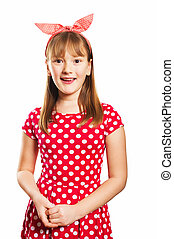 Studio shot of young little 9-10 year old girl, wearing red...