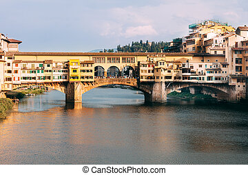 View of Ponte Vecchio and Arno River in Florence, Italy....