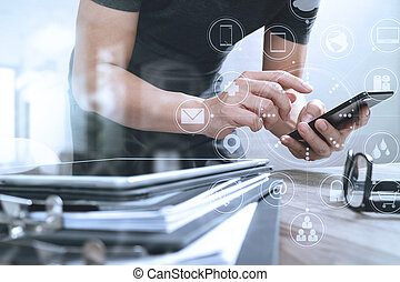 Designer hand using mobile payments online shopping,omni...