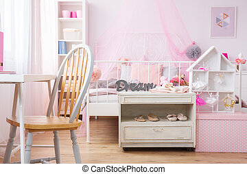 Study room and bedroom combined - Pink interior with study...