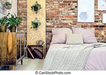 Industrial bedroom with pink bedding - Industrial bedroom...