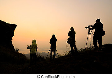 Silhouette of photography at sunrise. Phu Chi Fa in Chiang...