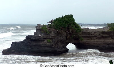 Panoramic view from the mountain near the Pura Tanah Lot temple on sea cliff in Bali, Indonesia