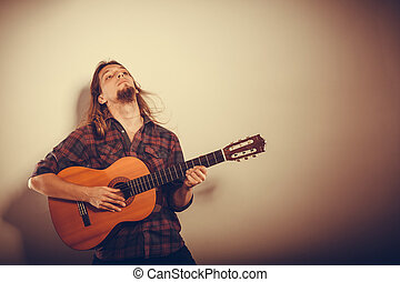 Enthusiast playing the instrument. - Music hobby passion...