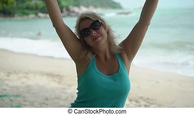 Young woman on swing on a beach - Young blonde woman on...