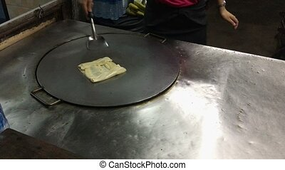 Streetfood in Asia - pancake cooking - Streetfood in Asia -...
