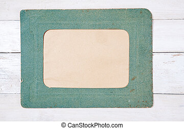 Retro photo frame on wooden background