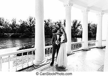Couple in the romantic place in the wedding day