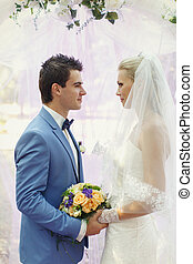Touching wedding ceremony of the young couple