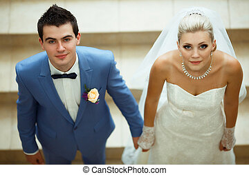 Bride and a groom with the blue eyes
