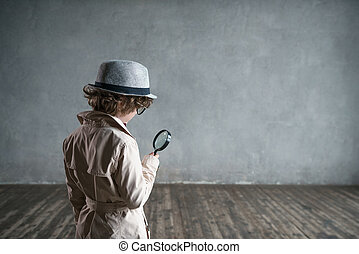 Pursuit - Little boy with a magnifying glass