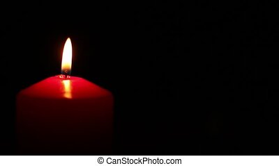 red candle lit and extinguished - Red candle lit and...