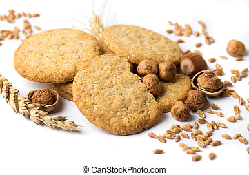 Integral cookies with hazelnuts and linseed on white...