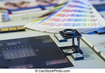 Color management in printing process with magnifying glass...