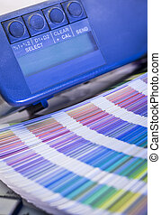 Color management in printing process with magnifying glass,...