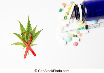 Marijuana leafs, fight cancer sign and medicaments on white...