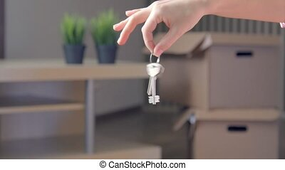 Woman Showing The House Keys, real time.