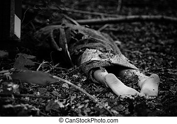 Bare feet of wrapped up dead body - Crop grayscale shot of...