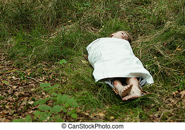 Dead boy body wrapped paper - Dead body of teenager with...