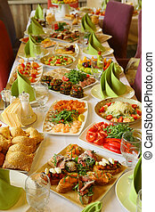 restaurant long table served with snack food