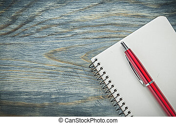 Set of biro pen blank notepad on wooden board office...