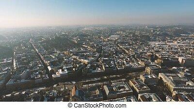 Winter Magic City at sunset. Aerial Old Winter City Lviv,...