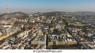 Winter Magic City at sunset. Aerial Old Winter City Lviv,...