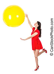 Woman catching big yellow balloon isloated on white background