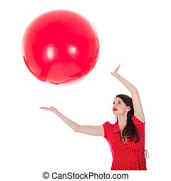 Woman catching big red balloon above her head