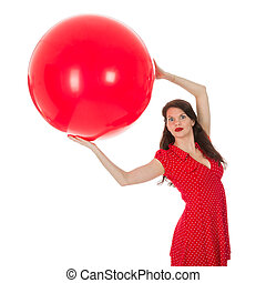 Woman holding big red balloon above her head