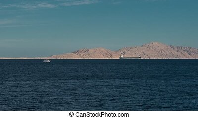 beautiful evening landscape of sea and mountains timelapse from right to left. Evening view of the red sea. boat in the sea. ship in the sea time lapse