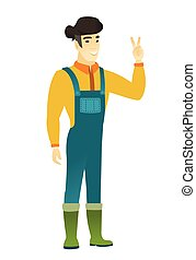 Asian farmer showing the victory gesture. - Asian farmer in...
