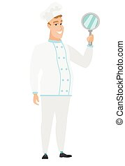 Caucasian chef cook holding hand mirror. Full length of chef...