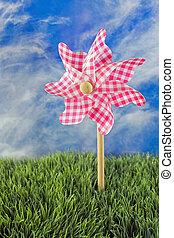 pink and gingham pinwheel - pink gingham pinwheel in grass