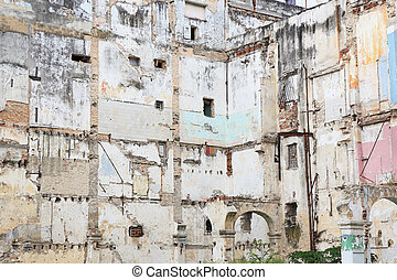 devastation - Walls of partially dismantled building in...