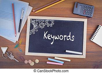 Keywords. Chalkboard on wooden office desk