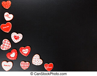 Beautiful gingerbread heart on a black background. Postcard...