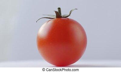 Fresh tomato rotation on white background.