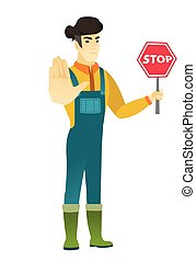 Asian farmer holding stop road sign. - Asian farmer showing...