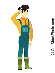 Young asian farmer in coveralls laughing. Happy farmer...