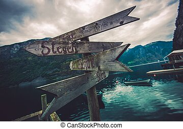 Wooden Direction Sign Somewhere in Norway. Traveling in...