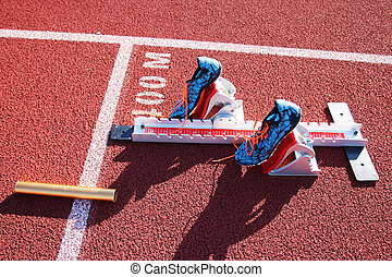 Starting blocks with spikes set in them on the track
