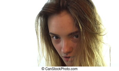young girl with wet hair turns her head and looks -...