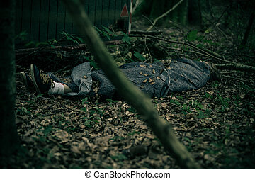 Murdered body in forest wrapped in tarpaulin - Murdered body...