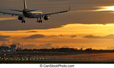 Commercial Aircraft Landing at Barcelona Airport at Sunset -...