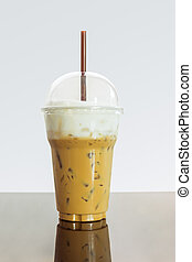 Iced coffee or caffe latte with milk foam in takeaway cup