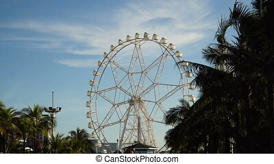 Ferris wheel at an amusement park. - Ferris wheel in Manila,...